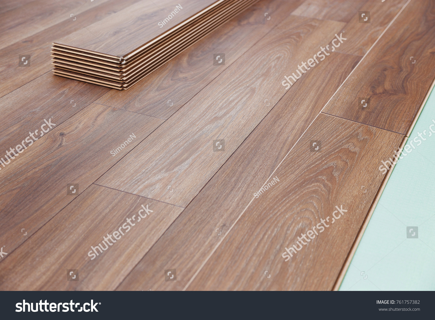 Installing Wooden Laminate Flooring With Soundproofing Sheets Laying