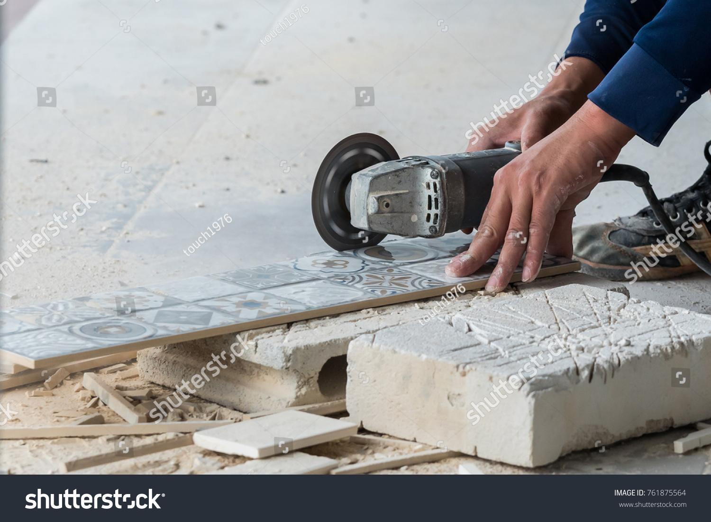 Disk grinder cutting tile work stock photo 761875564 shutterstock disk grinder cutting tile in work dailygadgetfo Images