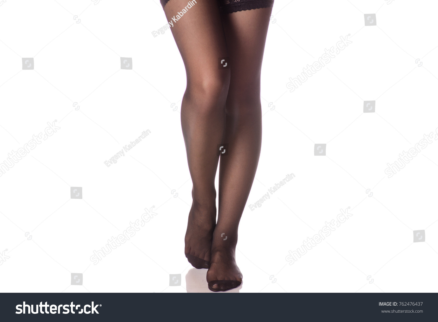 543d2a8622f Female legs black stockings tights on white background isolation