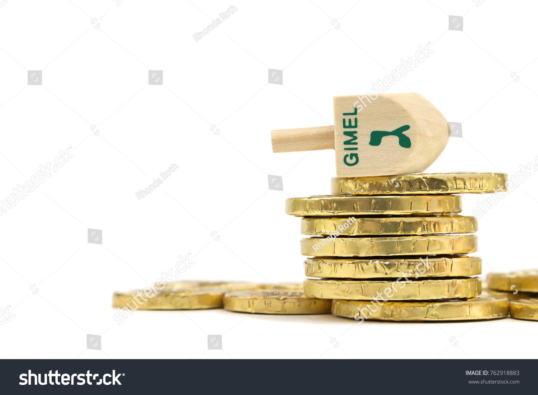Wooden dreidel stack gelt coins winning stock photo 762918883 wooden dreidel and stack of gelt coins the winning hebrew letter gimel is on the biocorpaavc