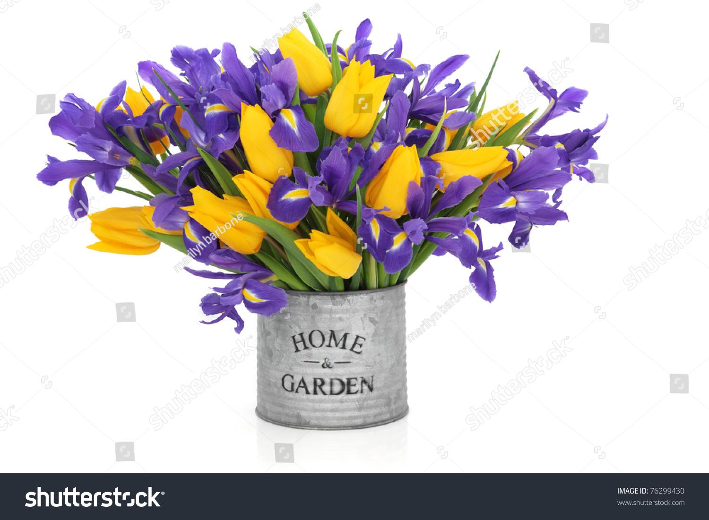Iris tulip flower arrangement old metal stock photo edit now iris and tulip flower arrangement in an old metal tin can with home and garden printed izmirmasajfo