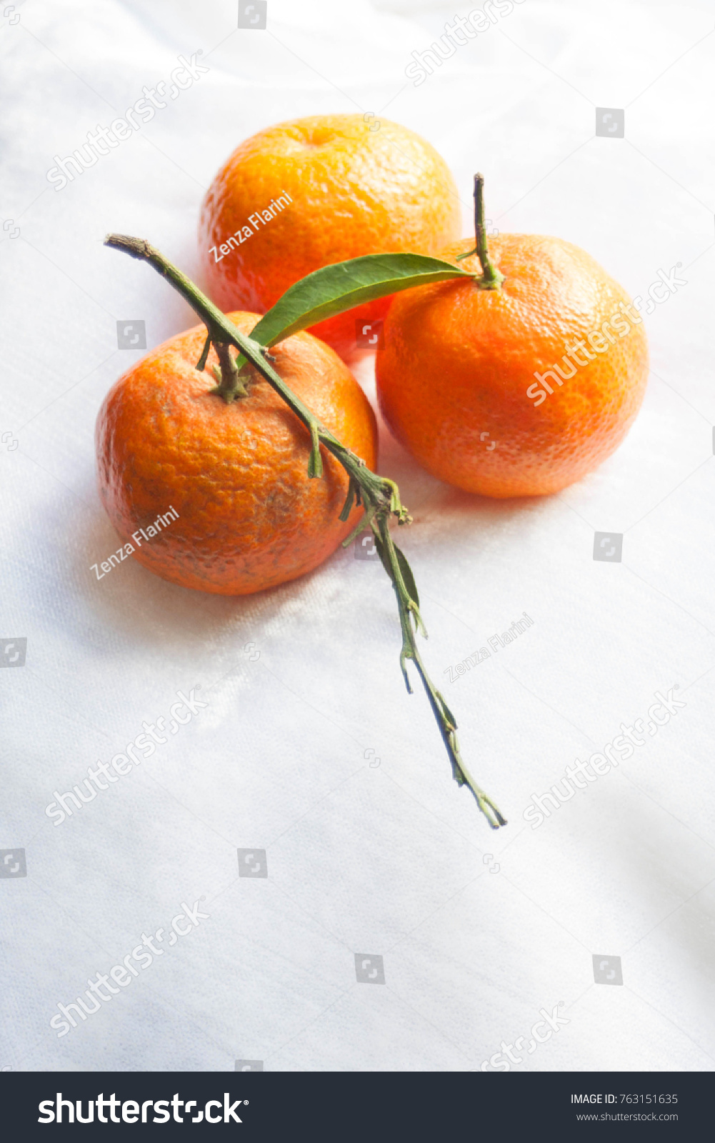 mandarin christmas oranges on a sunny snowy background holiday tangerines in bright natural - Christmas Oranges