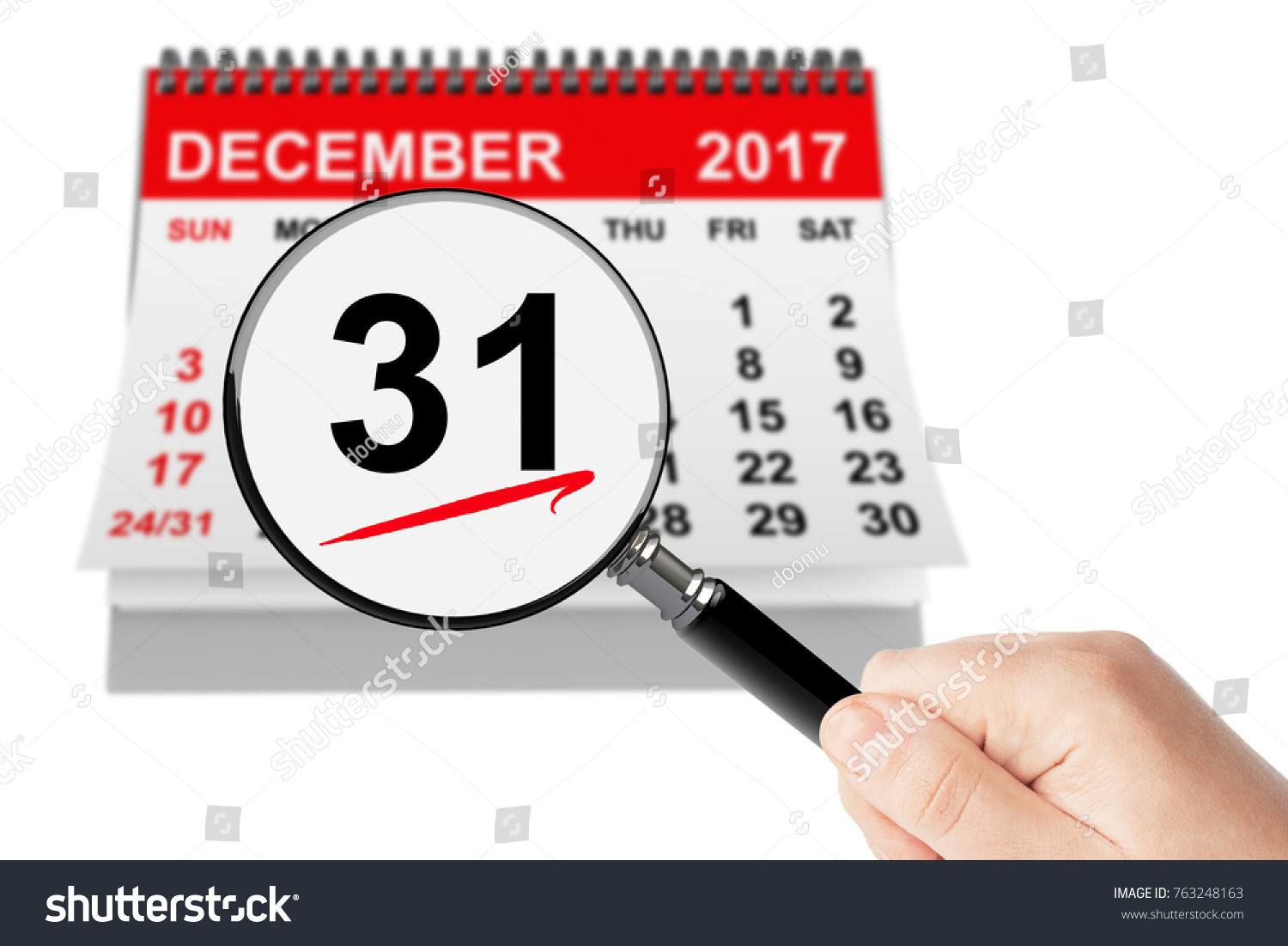 new year eve concept 31 december 2017 calendar with magnifier on a white background