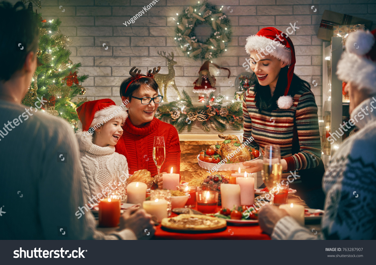 Merry Christmas! Happy family are having dinner at home. Celebration holiday and togetherness near tree. #763287907