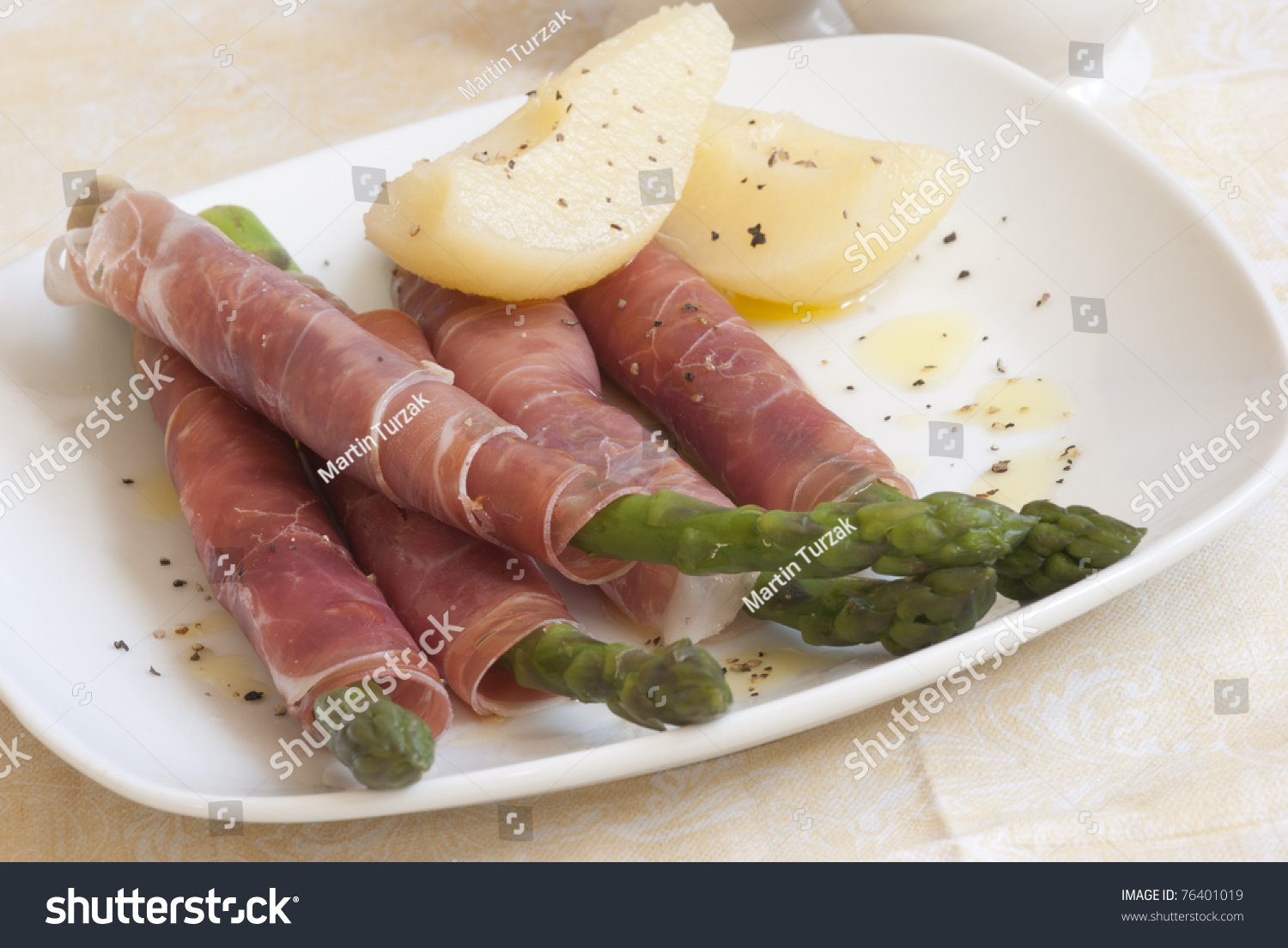 Cooked Asparagus Coated In Parma Ham With Pears On A Plate Preview Save To  A Lightbox