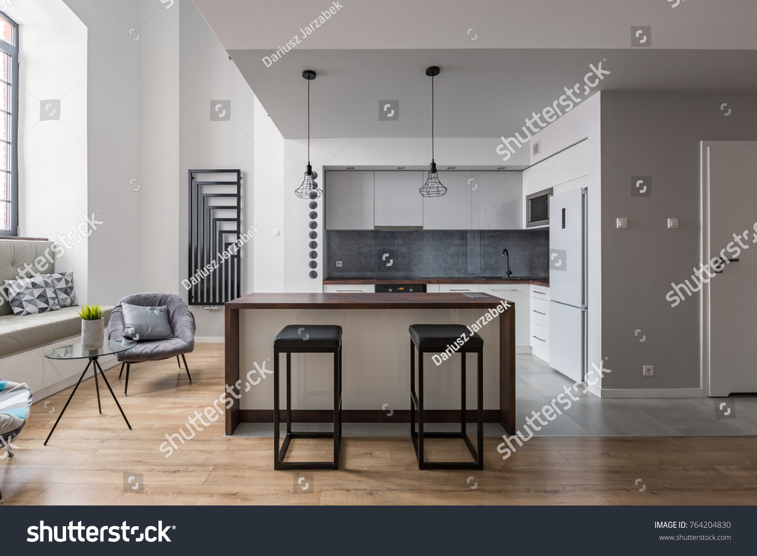 Contemporary interior with kitchen island bar stools and cozy window seat