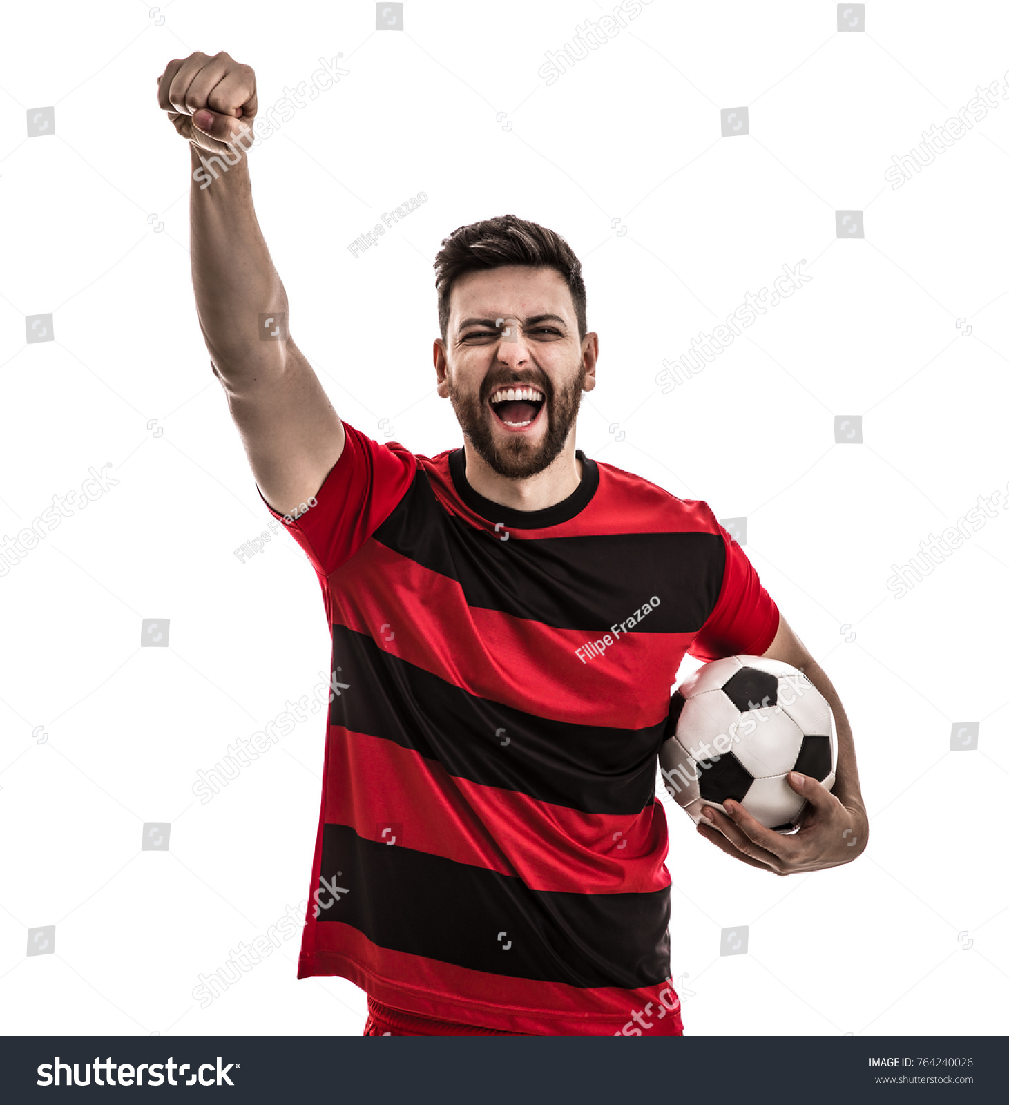 Male athlete / fan in red and black uniform celebrating on white background #764240026