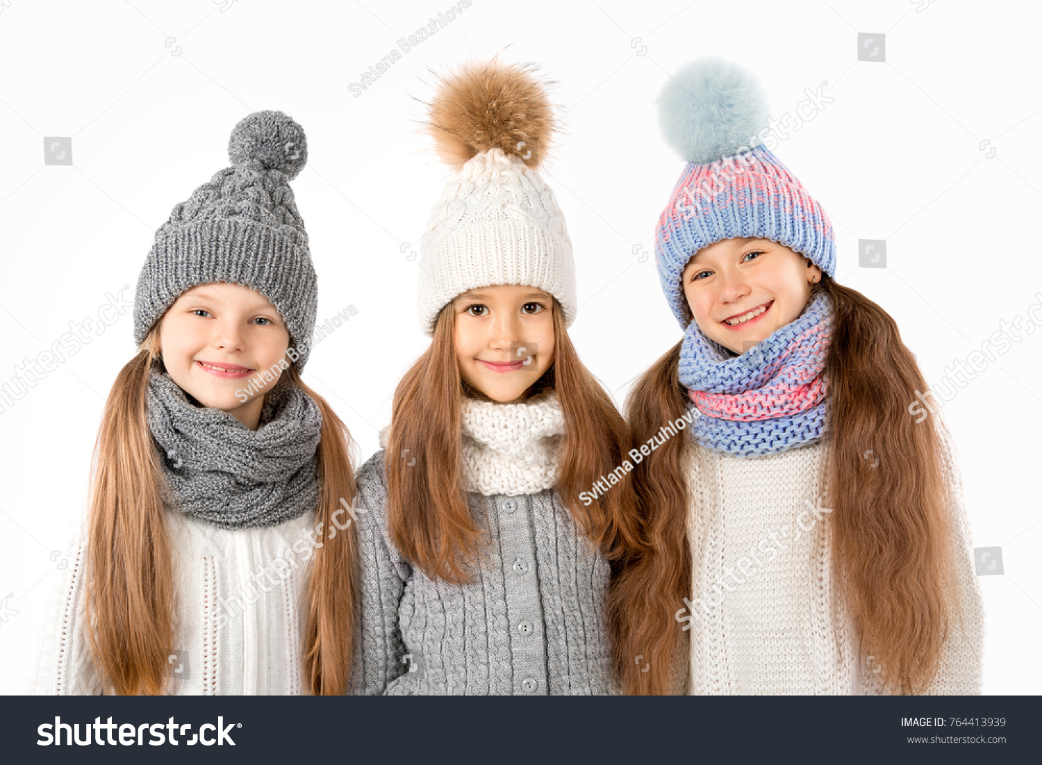9a4d633860861 Group of cute kids in winter warm hats and scarfs isolated on a white  background.