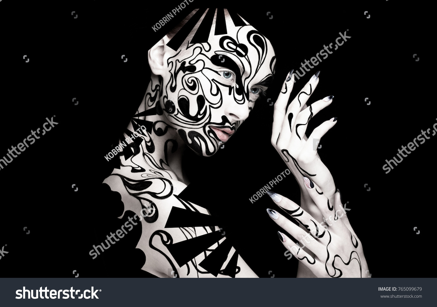Beautiful girl with art black and white makeup and nails creative beauty face photo