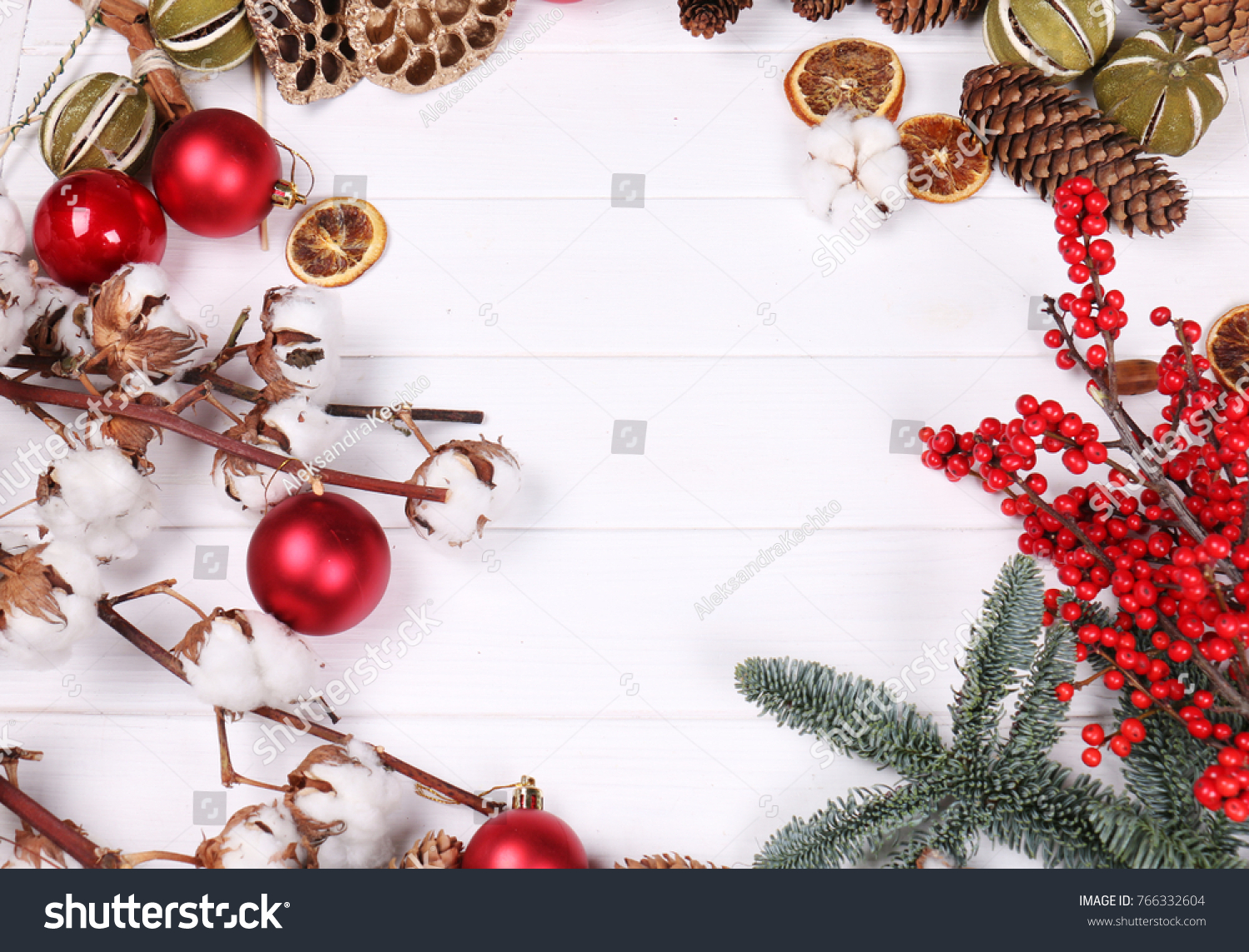stock photo christmas wallpaper with red balls and cones on a white background 766332604