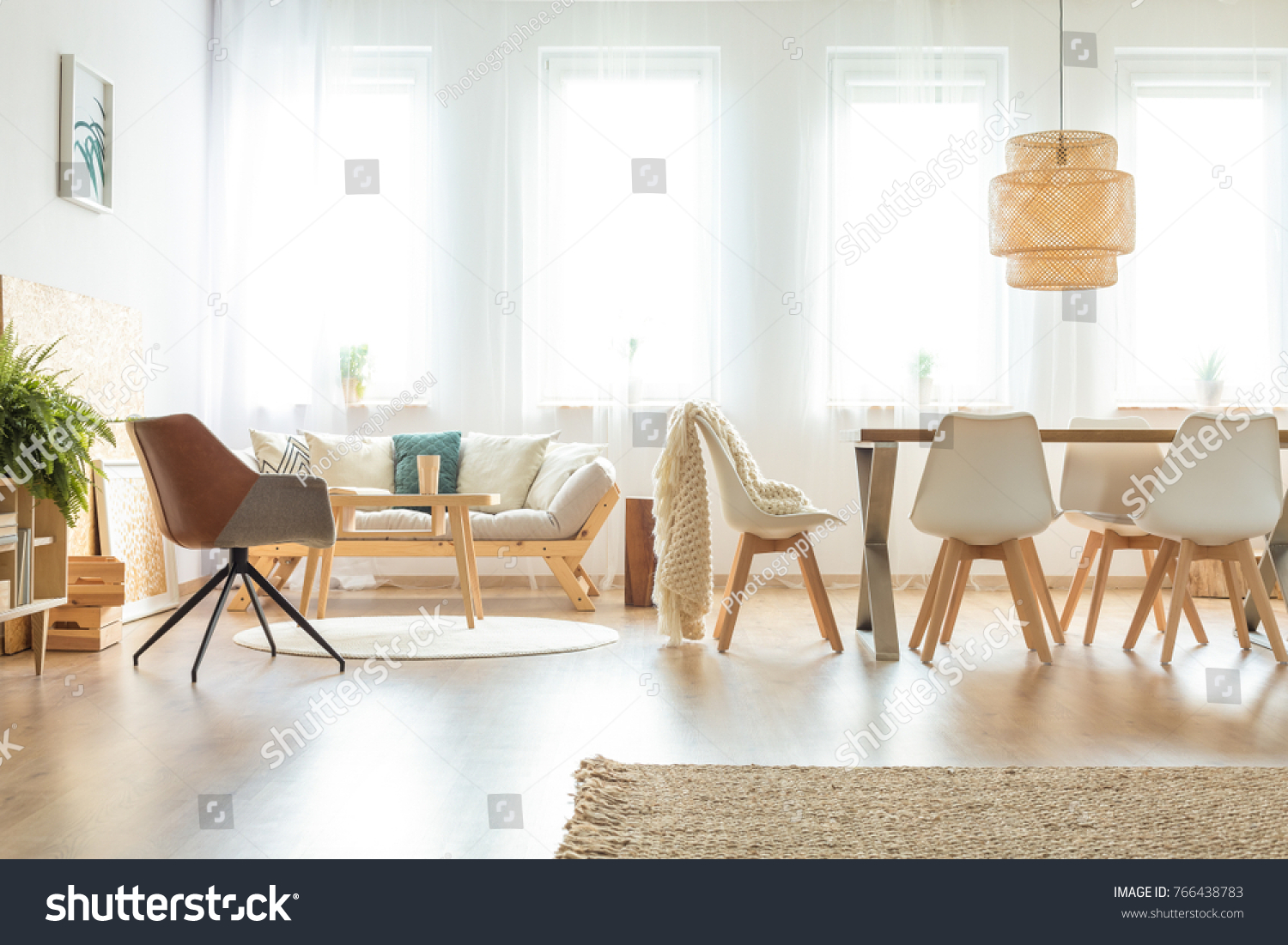 Vintage Chair And Sofa In Multifunctional Dining Room With Wooden Table  Under Lamp