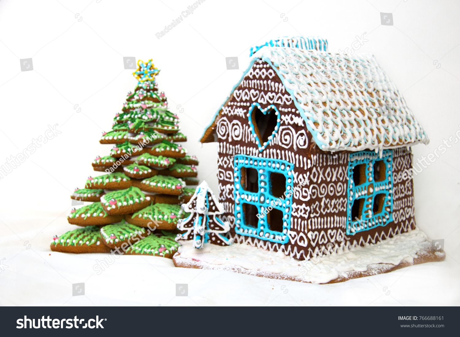 gingerbread christmas cake house and tree decorated with colourful sugar