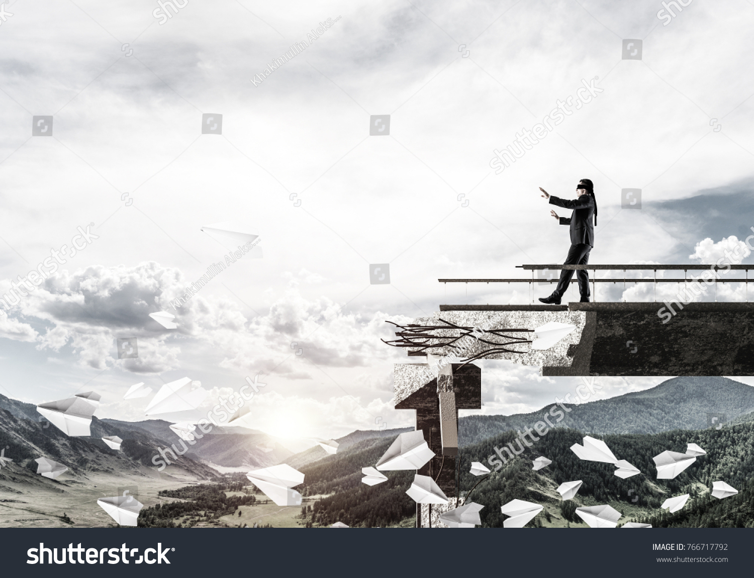 Businessman walking blindfolded on concrete bridge with huge gap as symbol of hidden threats and risks. Skyscape and nature view on background. 3D rendering. #766717792