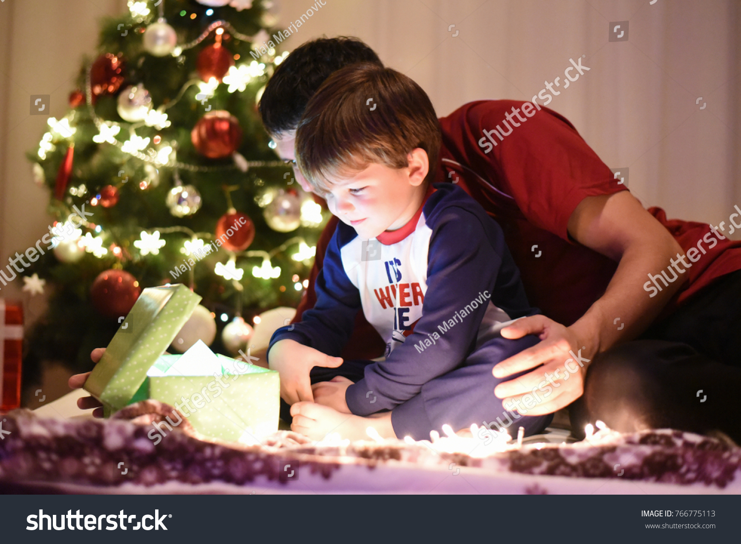 father gives christmas gift to his little son for a new year dan and son