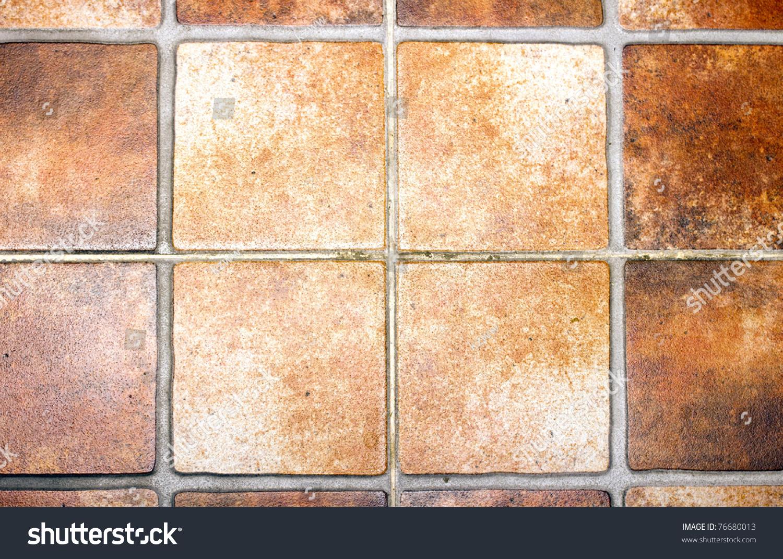 Closeup square terracotta ceramic tile floor stock photo 76680013 closeup of square terracotta ceramic tile floor background dailygadgetfo Images