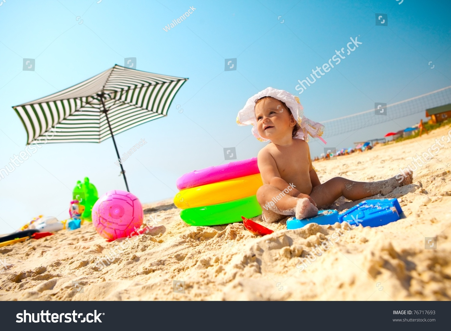 Beach Toys For Girls : Little baby girl on the sand beach with toys stock