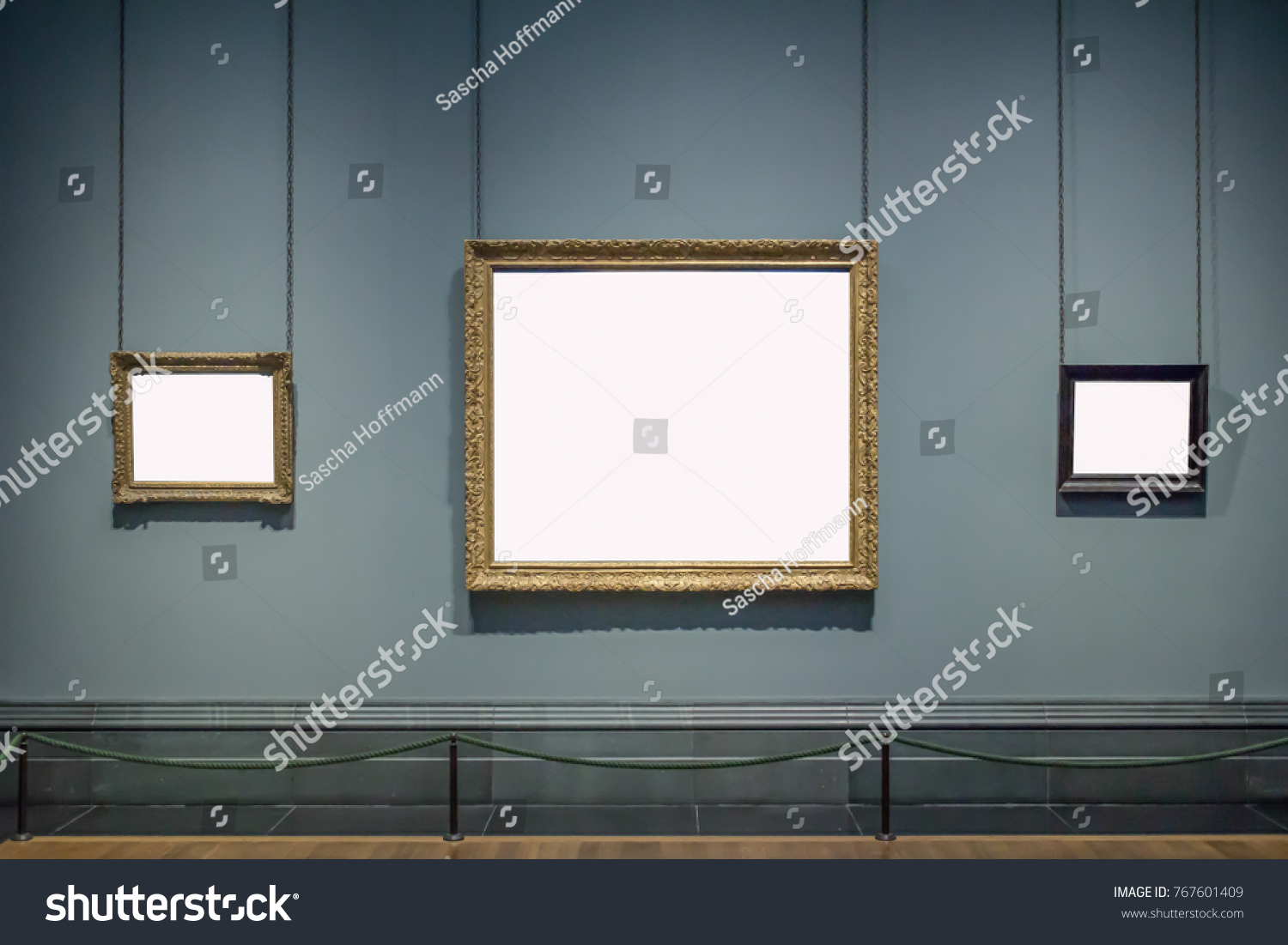 3 blank hanging individual frames in an art gallery museum exhibition template #767601409