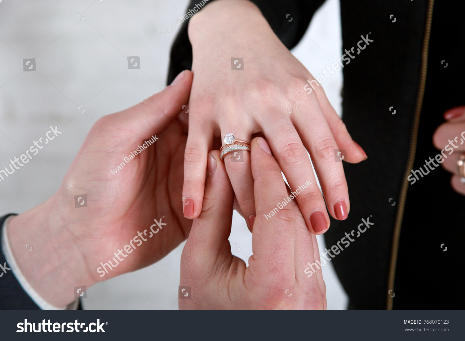 Grooms Hand Putting Wedding Ring On Stock Photo & Image (Royalty ...