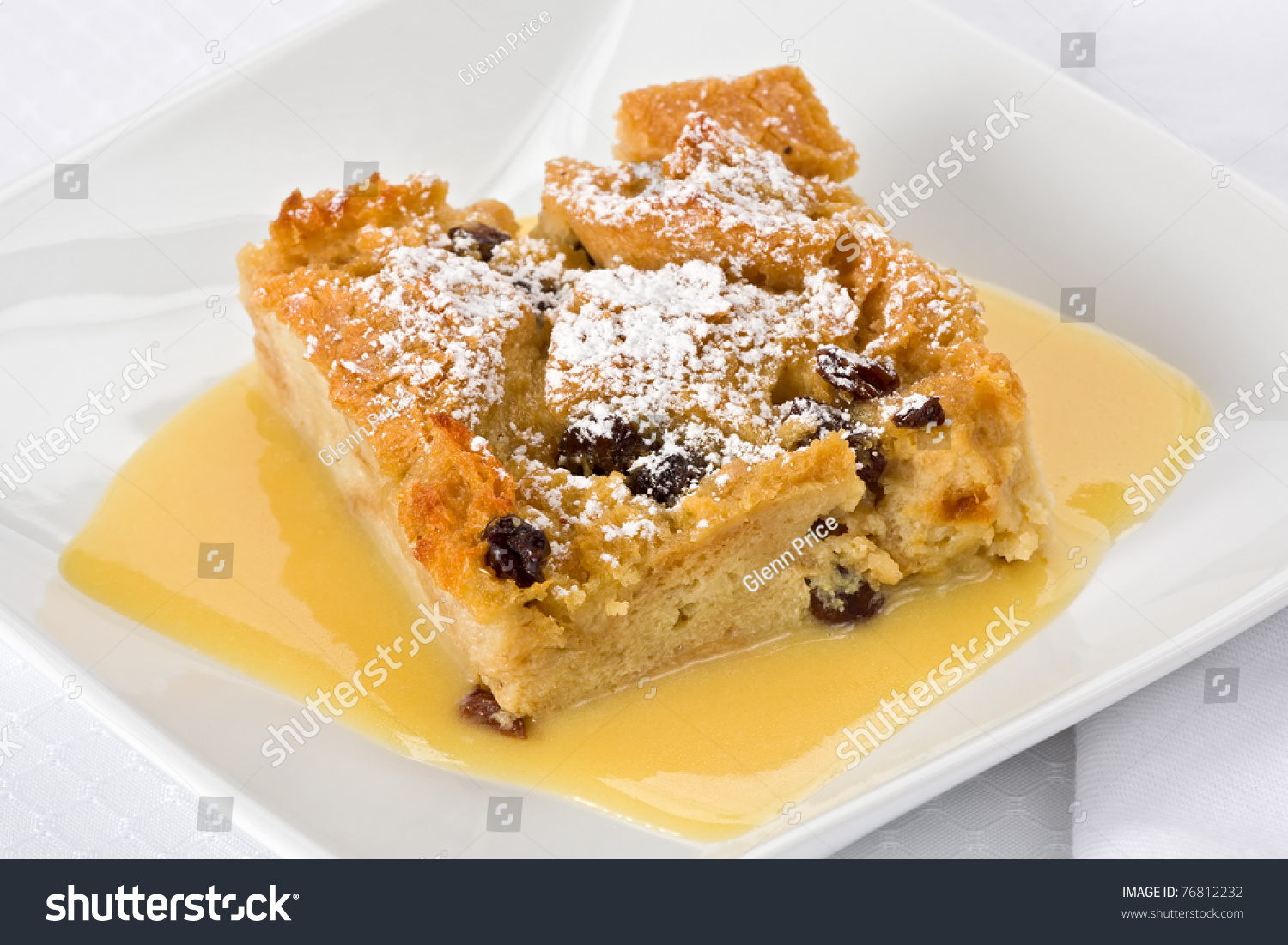 Bread Pudding With Bourbon Sauce On A Square Plate. Stock Photo ...