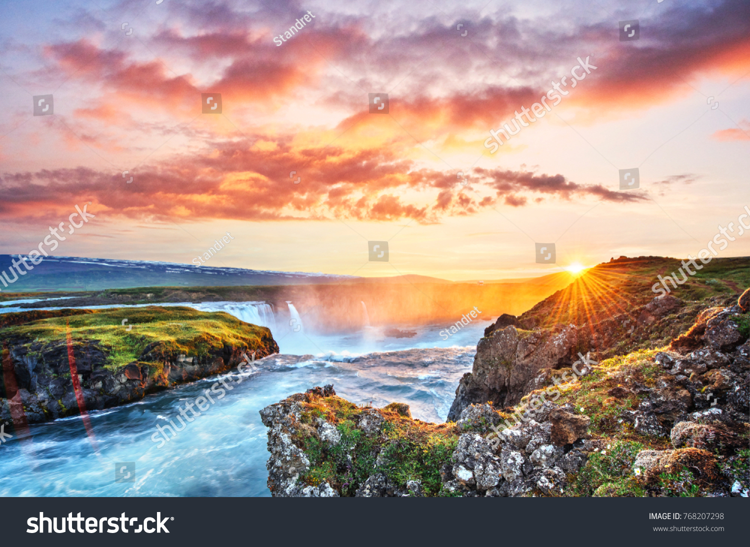 The picturesque sunset over landscapes and waterfalls. Kirkjufell mountain, Iceland #768207298