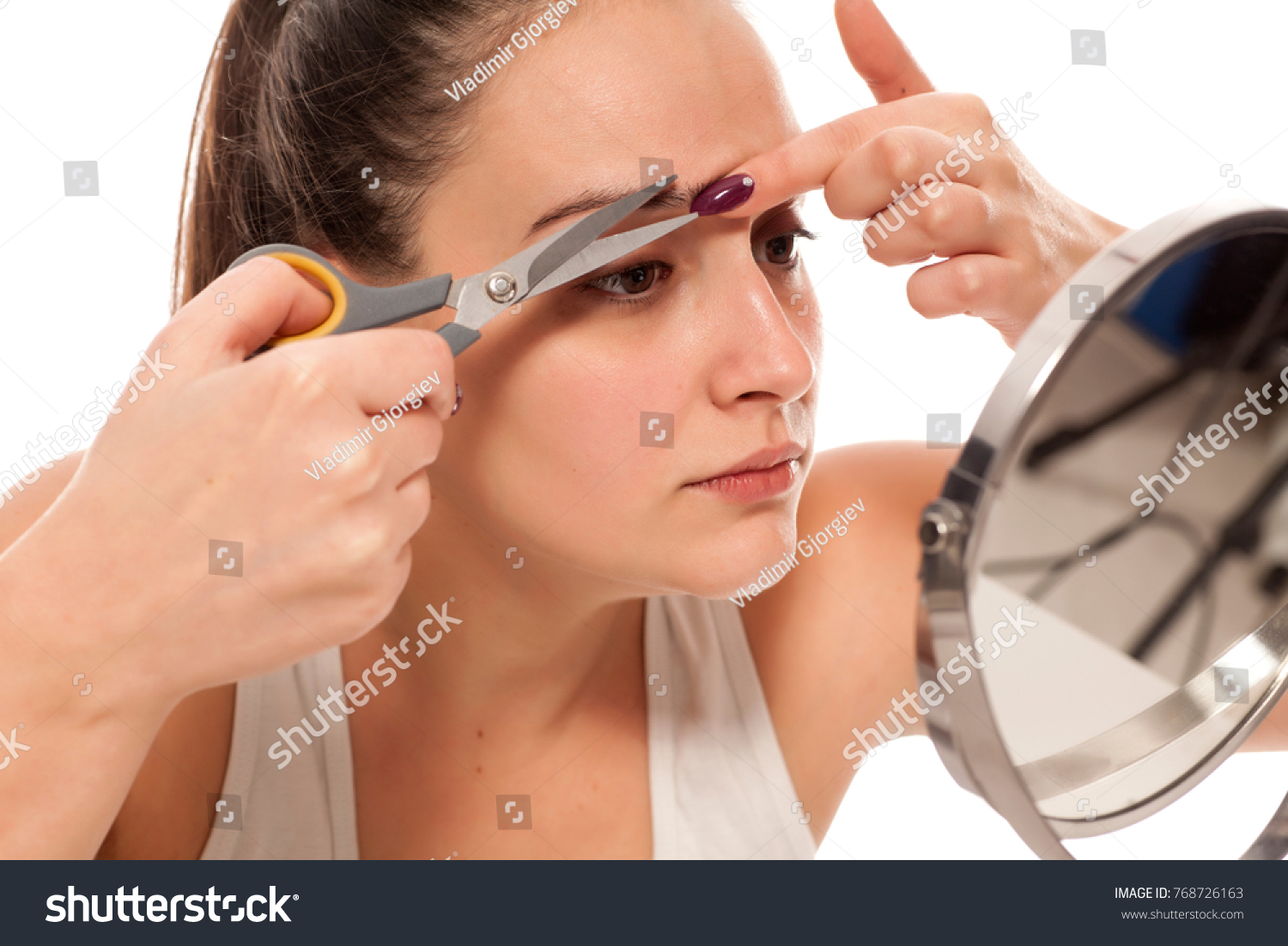 Young Woman Trimming Her Eyebrows Mirror Stock Photo Edit Now
