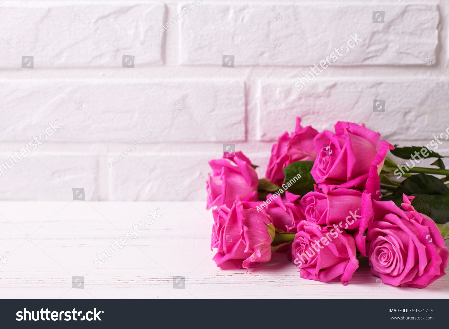 Bunch Of Pink Roses Flowers On White Wooden Background Against White