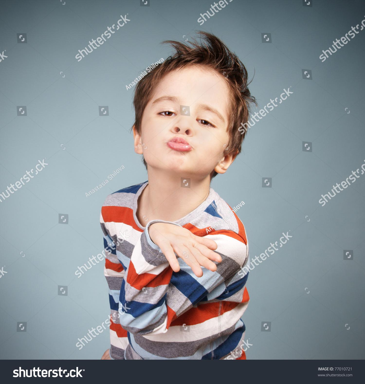 Portrait grimacing little boy blowing kiss stock photo edit now portrait of grimacing little boy blowing a kiss studio shot altavistaventures Images
