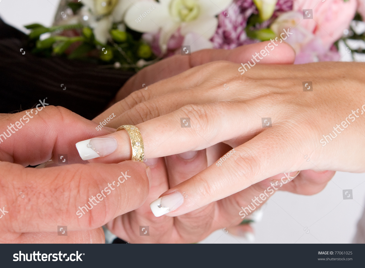 Groom Putting Wedding Ring On Brides Stock Photo (Edit Now) 77061025 ...