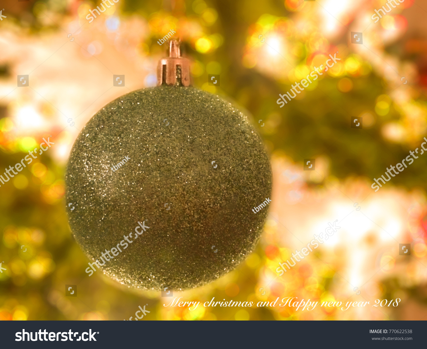 christmas ball hang on christmas tree with copy space for text merry christmas and happy