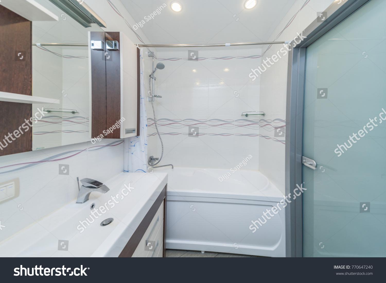Small Beige Tile Bathroom Bath Tube Stock Photo (Royalty Free ...