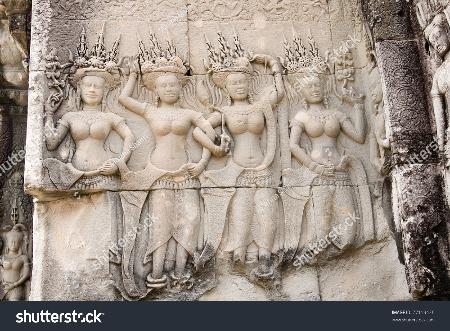 Dancing apsaras an old khmer art carvings on the wall in