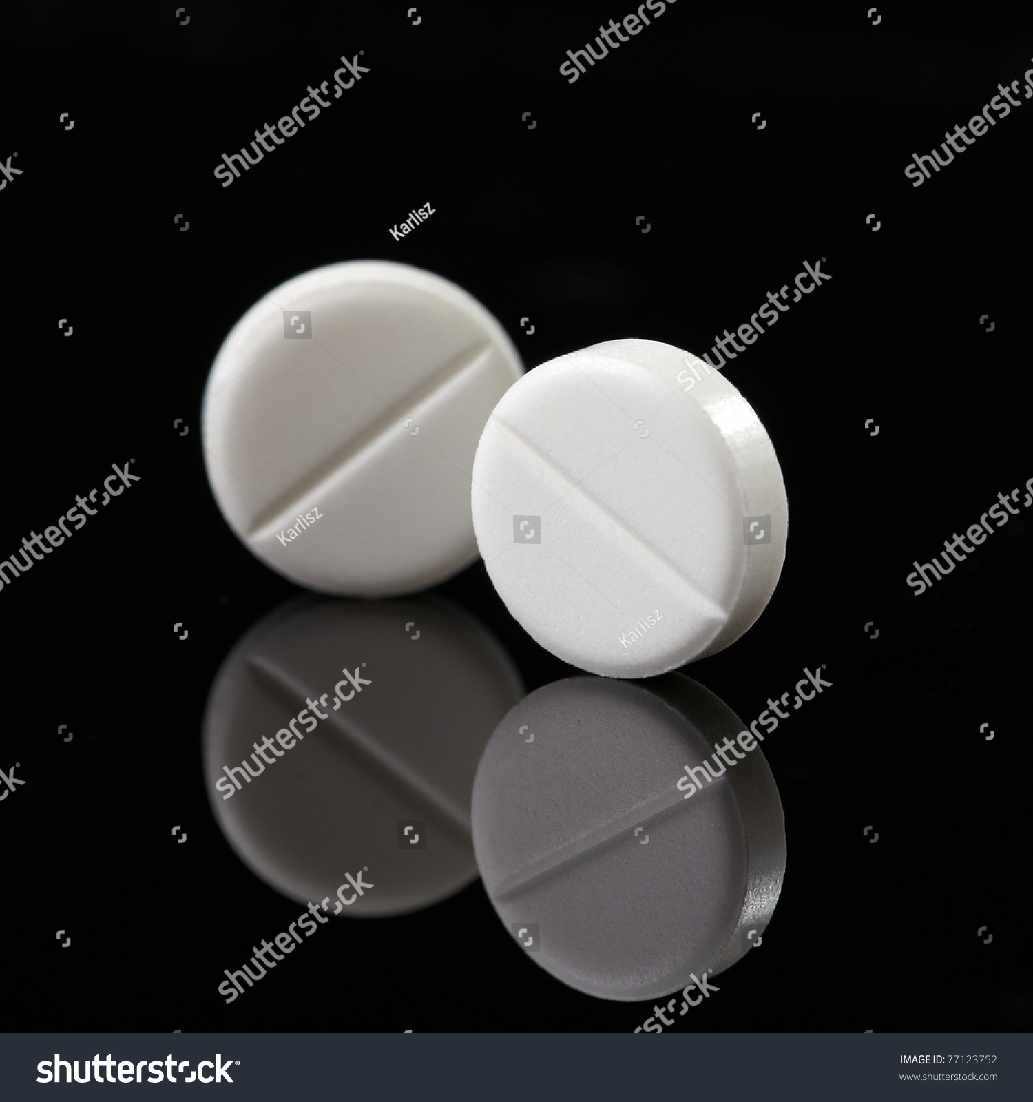 white pills on black background stock photo 77123752