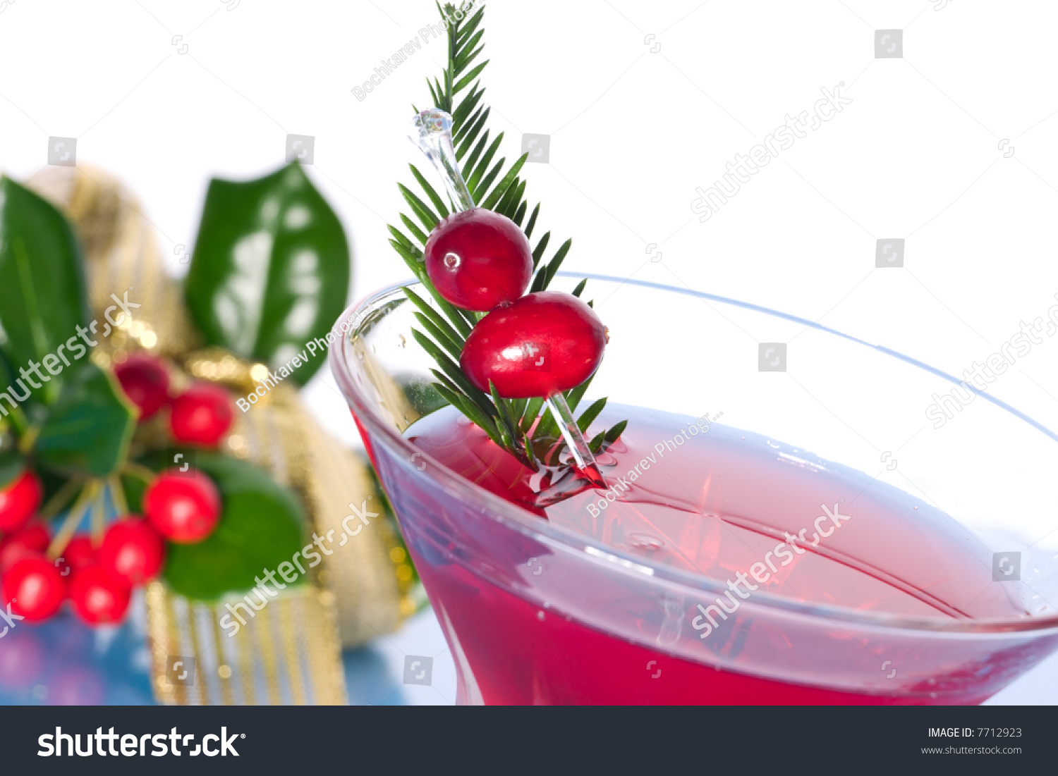 Closeup of cosmopolitan cocktail in martini glass and for Christmas in a glass cocktail