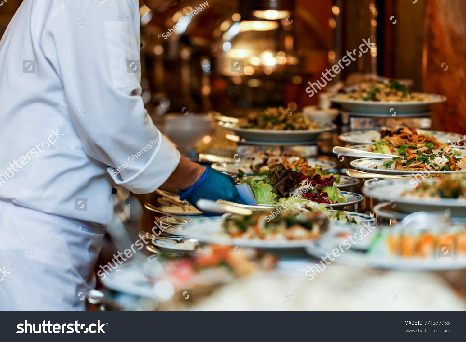 Chef arranging food on buffet table stock photo edit now 771377755 chef is arranging the food on buffet table watchthetrailerfo