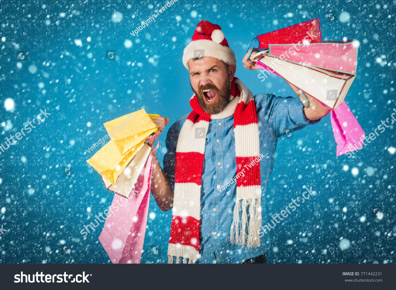 4e32c3082129f christmas new year snow concept Christmas hipster hold shopping bags on  blue background. Black friday