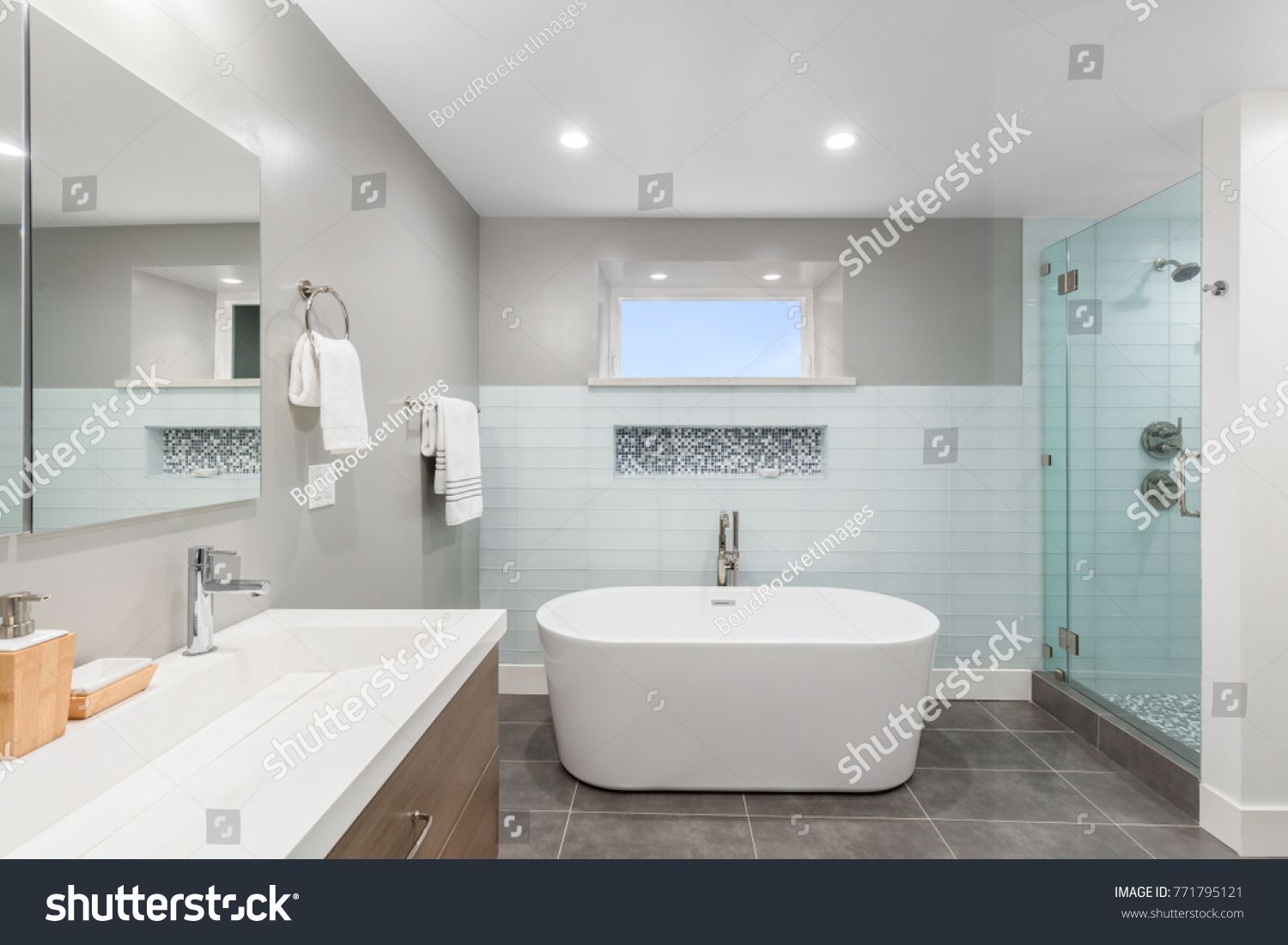 Luxury bathroom interior with an oval bathtub stone tiles and with ...