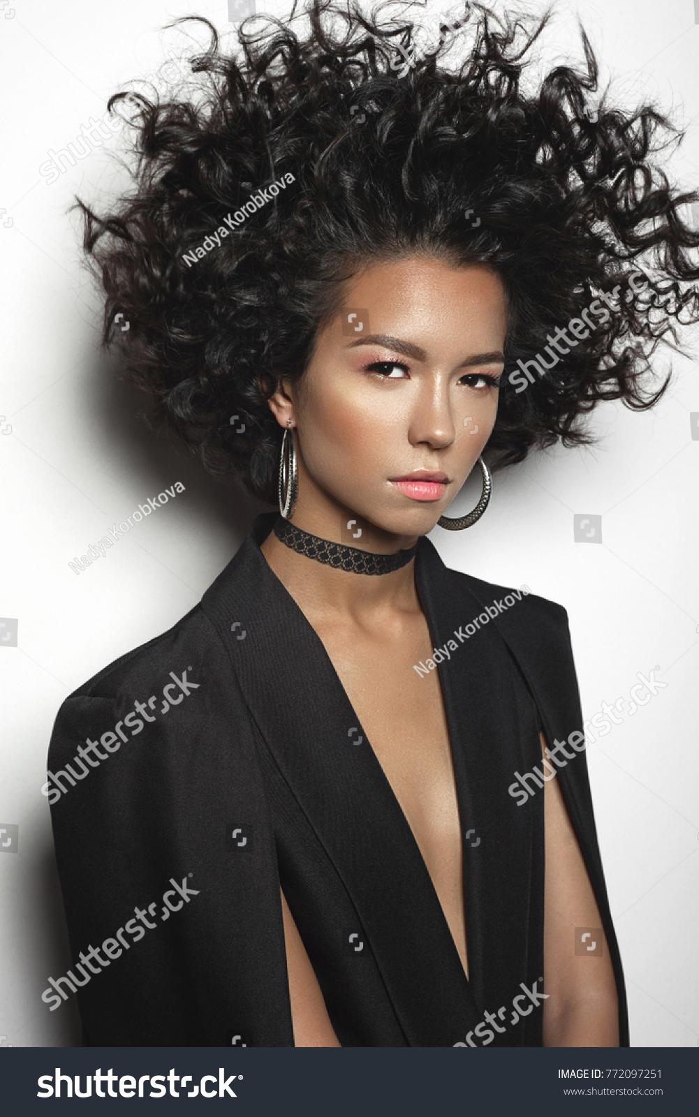 Fashion Studio Portrait Of Beautiful Woman With Afro Curls Hairstyle. Fashion  And Style. Beauty