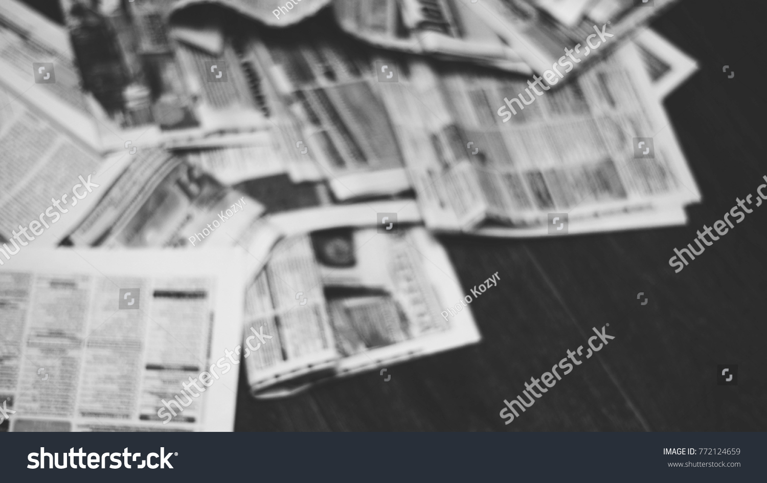 old newspapers scattered on wooden floor stock photo (edit now