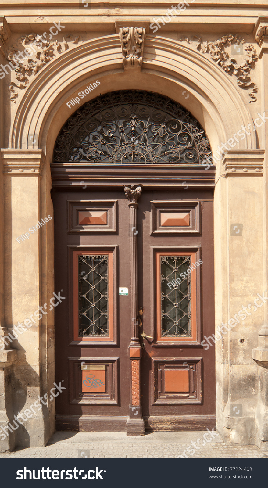 Historical ornate wooden door in a stone entry prague for Door z prague