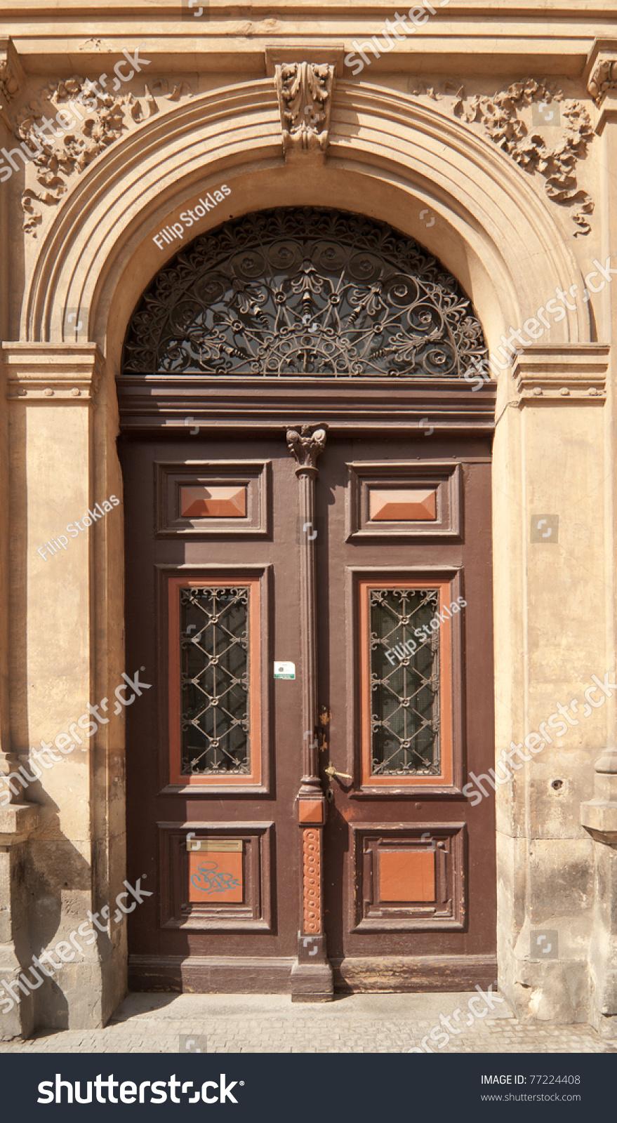 Historical ornate wooden door in a stone entry prague for Door z prague