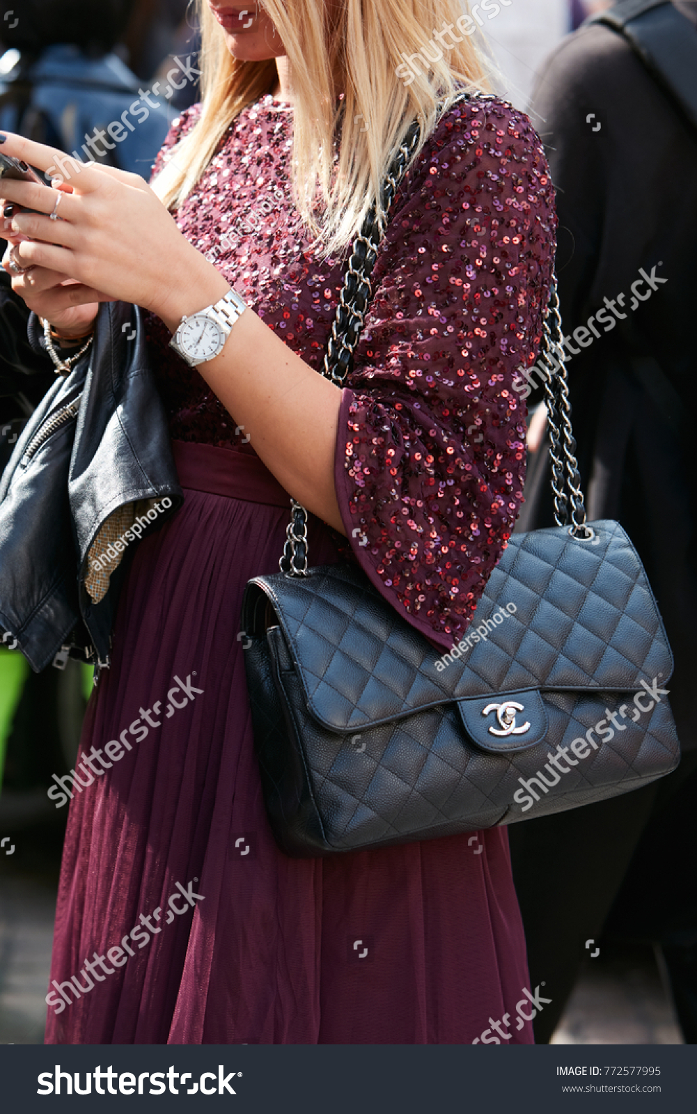 4539033e923aa9 MILAN - SEPTEMBER 23: Woman with Rolex watch, Chanel bag and dark red sequin