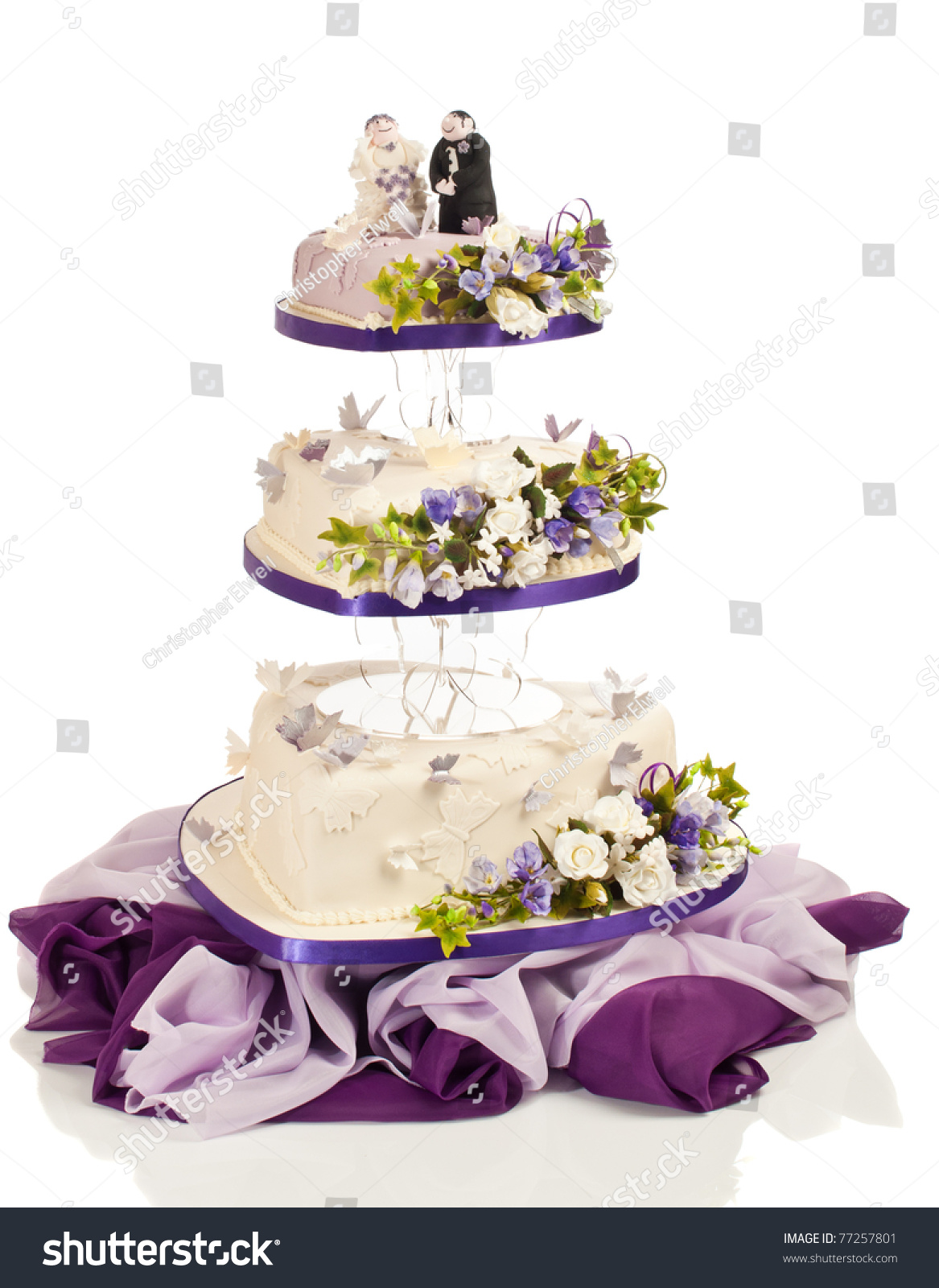 Heart Shaped Wedding Cake In Three Tiers With Flowers And Butterflies Made  From Sugar Icing On