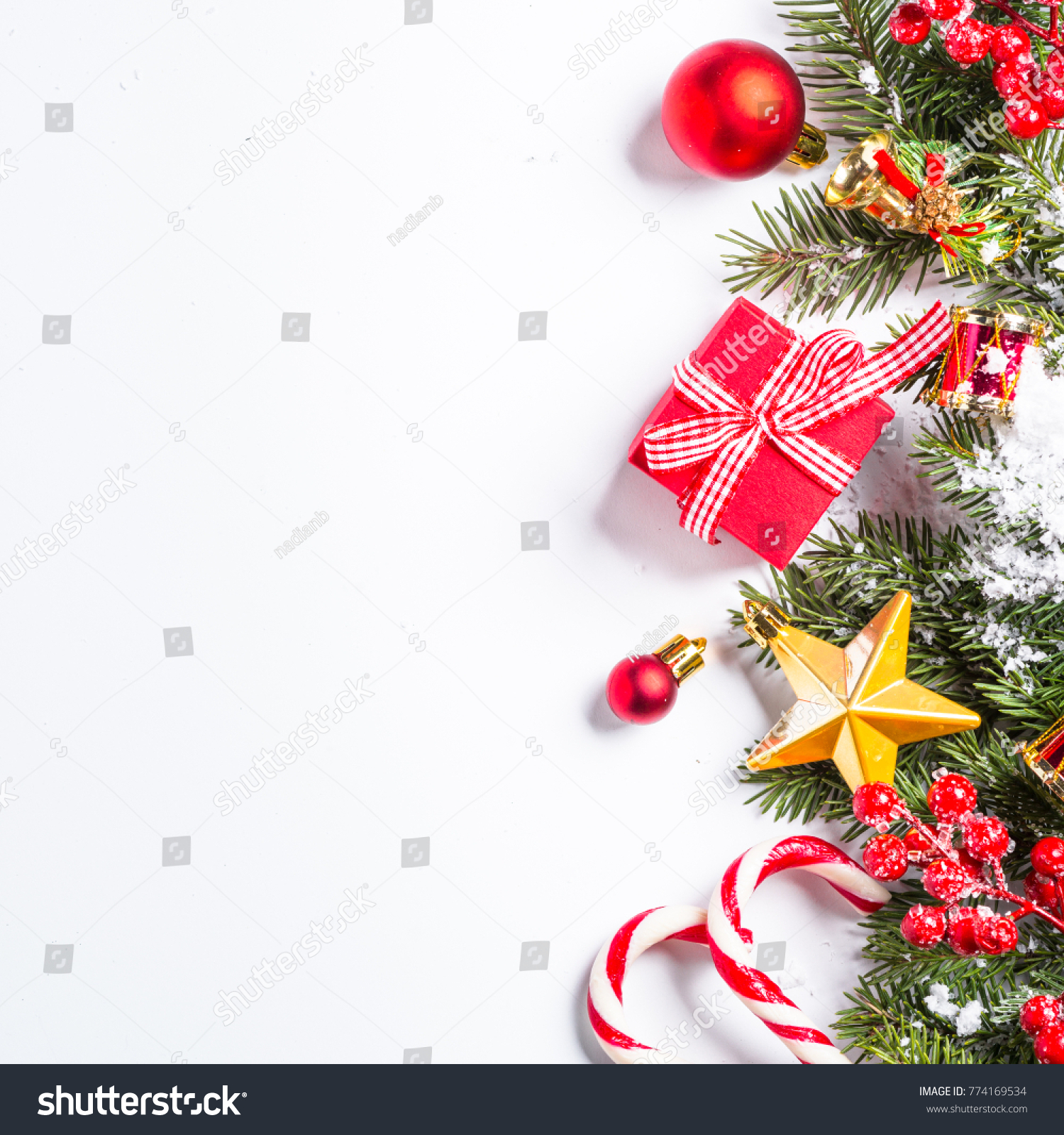 stock photo christmas background red and gold christmas decorations with snow fir tree branch on white 774169534