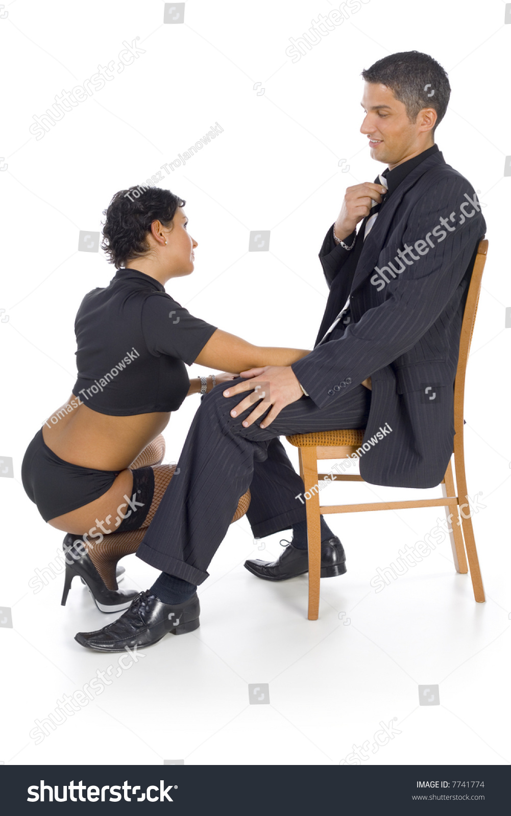 Man sitting in chair side - Stripteaser Squatting In Front Of Businessman The Man Is Sitting On Chair Isolated On