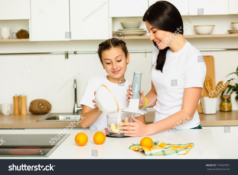Daughter Helps Mom Prepare Breakfast Mixing Stock Photo (Royalty ...