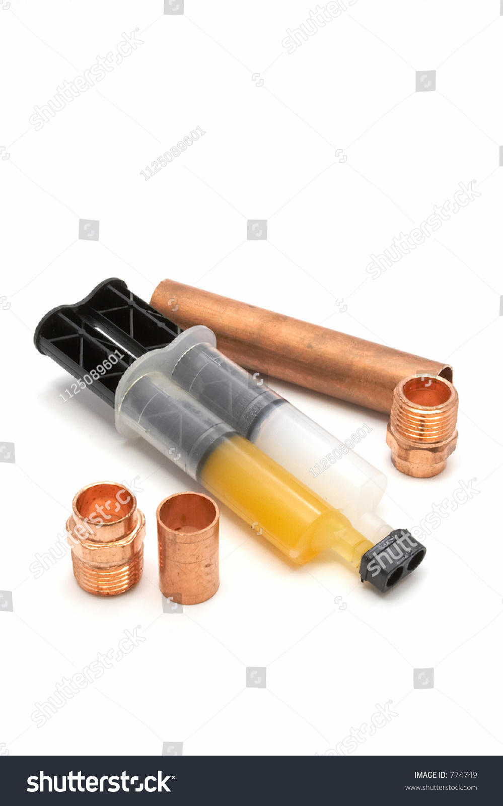 Copper pipe fittings epoxy joining stock photo