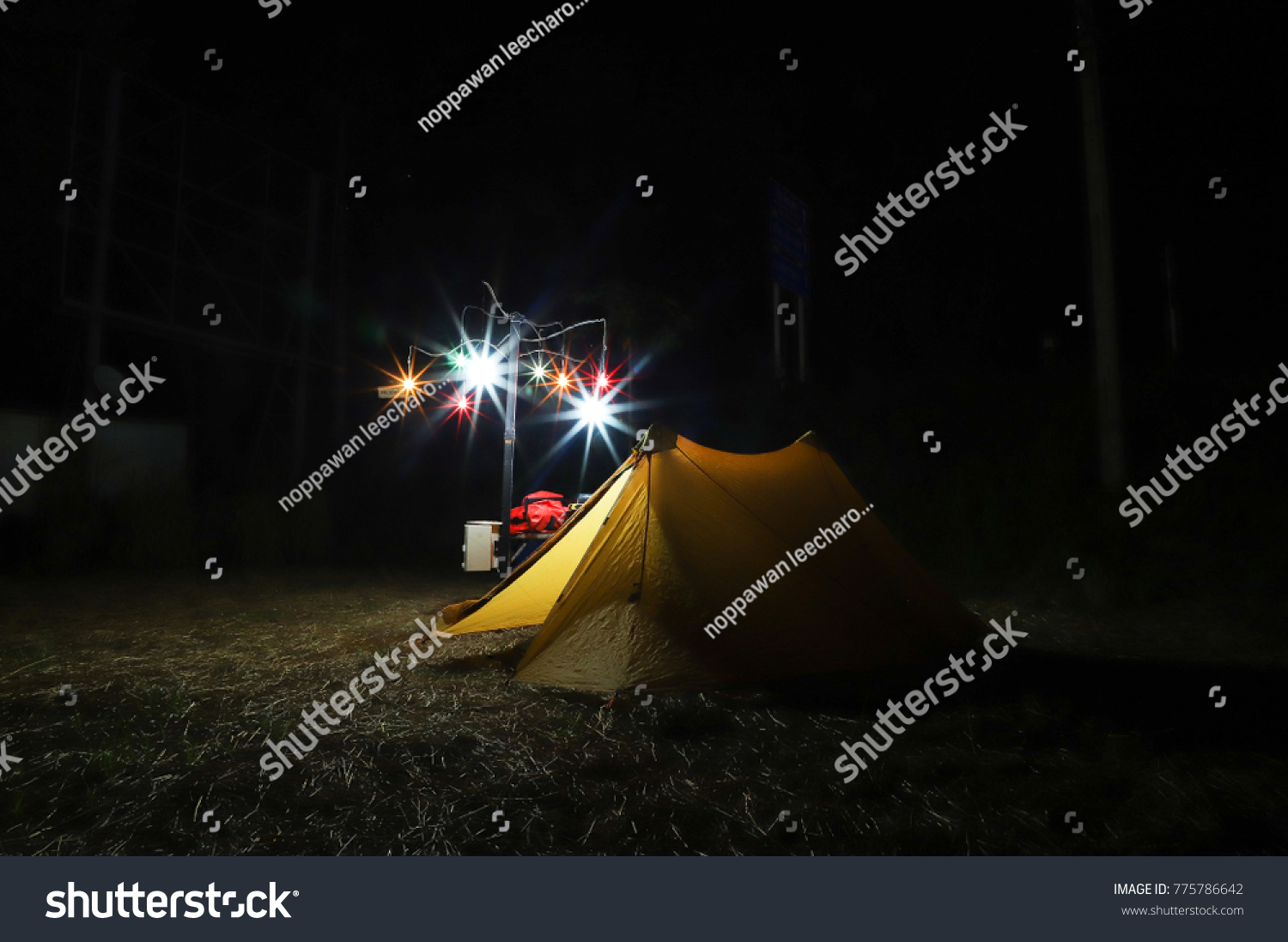 Bright yellow tent in the dark with starlight and blue skies. & Bright Yellow Tent Dark Starlight Blue Stock Photo (Edit Now ...