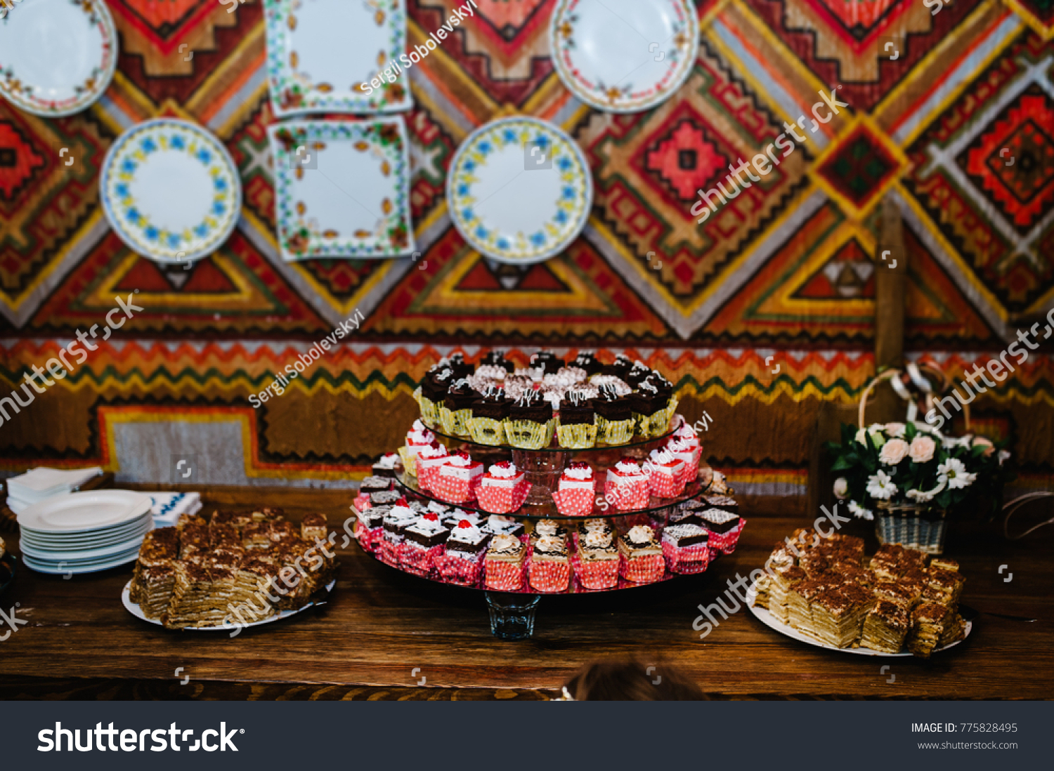 A plates of cakes and muffins with cream with berries. Table with & Sweet Table Plates Cakes Muffins Cream Stock Photo (Royalty Free ...