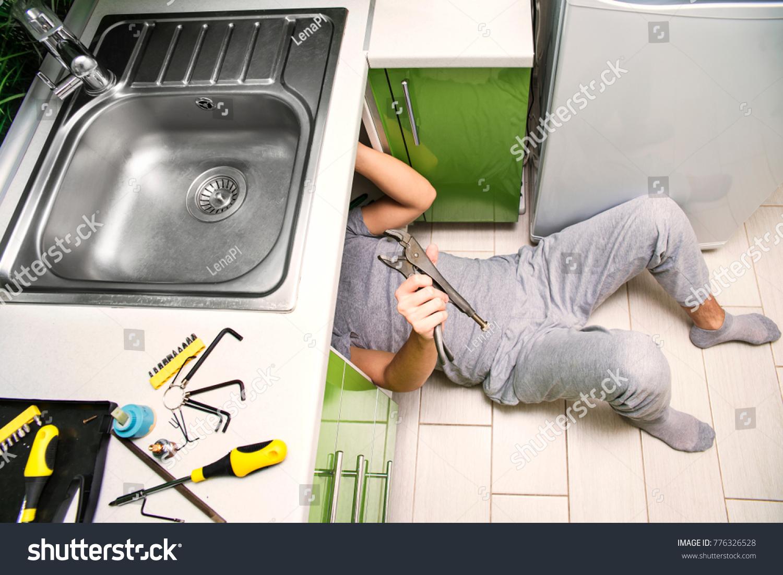 Plumber Repairing Faucet Sink Kitchen Man Stock Photo (Royalty Free ...