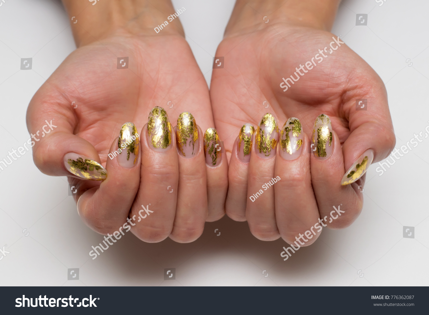 Gold Manicure On Long Oval Nails Stock Photo (Royalty Free ...